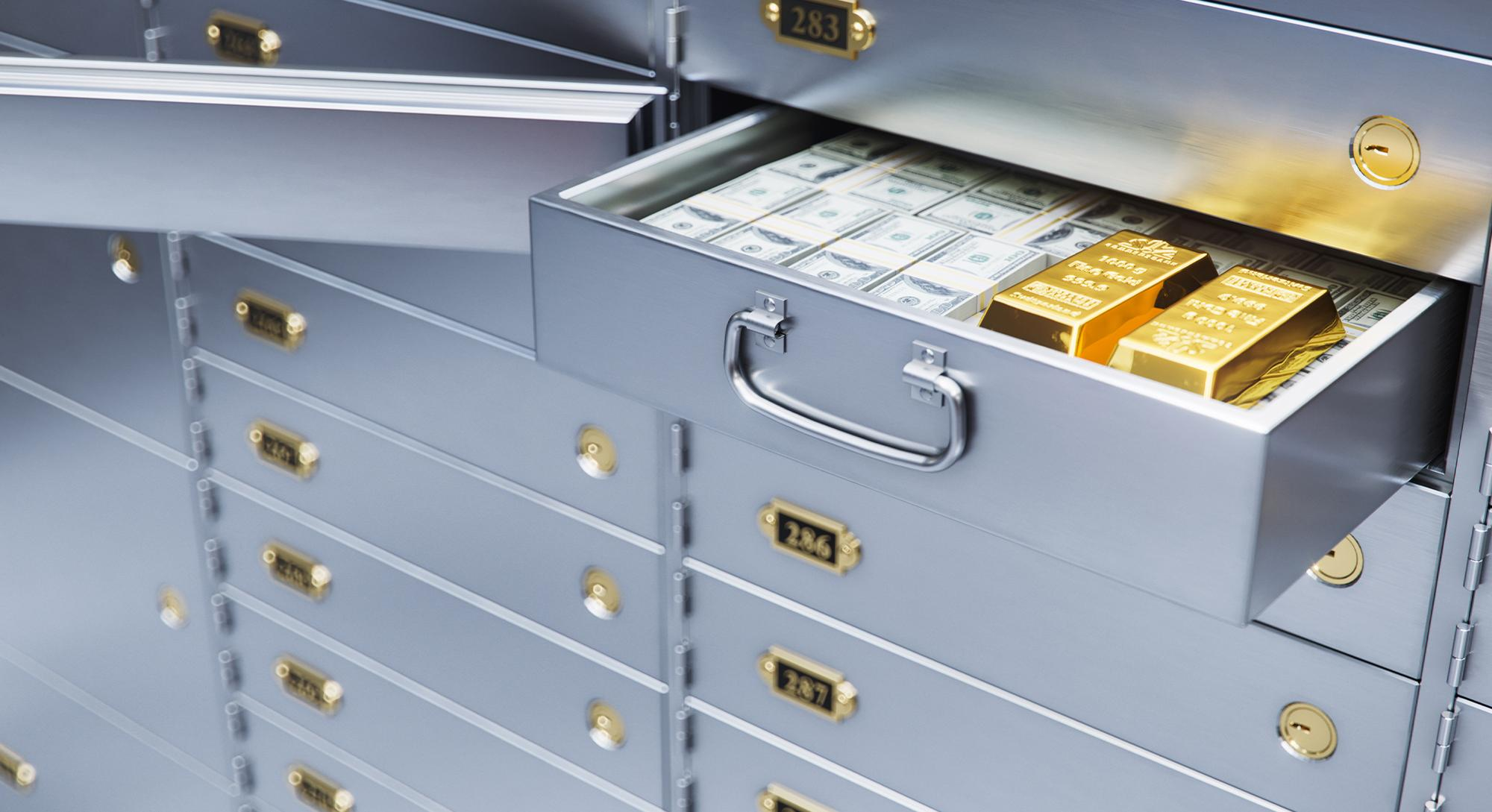 safe deposit box with money and gold